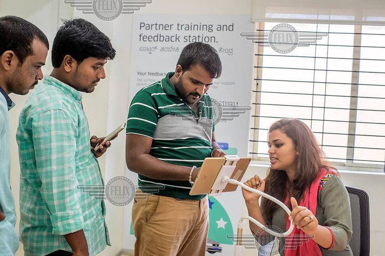 New drivers getting training on how to use the Uber app at the Uber office in Banglore.