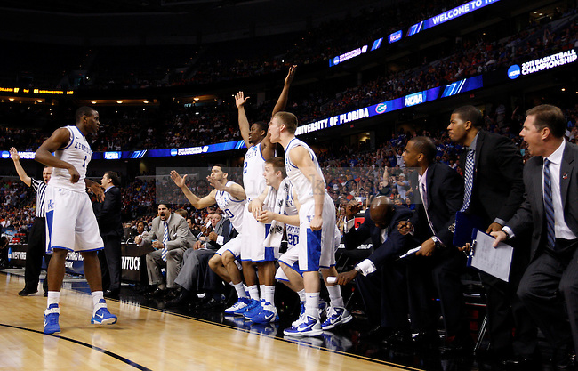 Everyone on the bench jumps up as Darius Miller makes a three in the second half of UK's second round NCAA tournament win, 71-63, against West Virginia at the St. Pete Times Forum in Tampa, Florida on Saturday, March 19, 2011.  Photo by Britney McIntosh | Staff