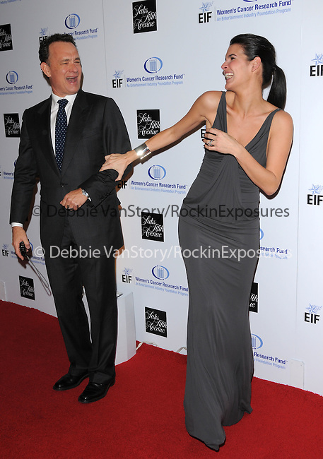 """Angie Harmon Sehorn & Tom Hanks at The Saks Fifth Avenue's """"Unforgettable Evening"""" benefiting EIF's Women's Cancer Research Fund held at The Beverly Wilshire Hotel in Beverly Hills, California on February 10,2009                                                                     Copyright 2009 Debbie VanStory/RockinExposures"""