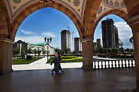 Women walk under arches of Grozny Central Dome Mosque, the largest mosque in Europe, near buildings under construction. After the war no buildings were left standing, but the city is now undergoing a rapid regeneration.
