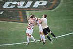 HOUSTON, TX - DECEMBER 11:  Teammates Foster Langsdorf (2) and Drew Skundrich (12) of Stanford University compete against Brad Dunwell (12) of Wake Forest University during the Division I Men's Soccer Championship held at the BBVA Compass Stadium on December 11, 2016 in Houston, Texas.  Stanford defeated Wake Forest 1-0 in a penalty shootout for the national title. (Photo by Justin Tafoya/NCAA Photos via Getty Images)