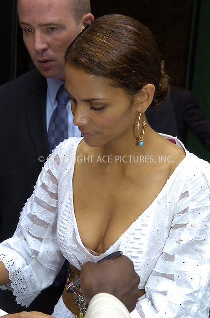 WWW.ACEPIXS.COM . . . . .  ....NEW YORK, JULY 13, 2005....Halle Berry takes a moment to sign autographs after a press conference for the America Heart Association.....Please byline: Philip Vaughan -- ACE PICTURES.... *** ***..Ace Pictures, Inc:  ..Craig Ashby (212) 243-8787..e-mail: picturedesk@acepixs.com..web: http://www.acepixs.com
