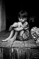 A child in the yard of the hospital waiting for treatment