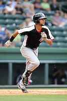 Outfielder Nomar Mazara (12) of the Hickory Crawdads in a game against the Greenville Drive on Sunday, June 9, 2013, at Fluor Field at the West End in Greenville, South Carolina. Mazara is the No. 16 prospect of the Texas Rangers, according to Baseball America. Hickory won, 6-3. (Tom Priddy/Four Seam Images)