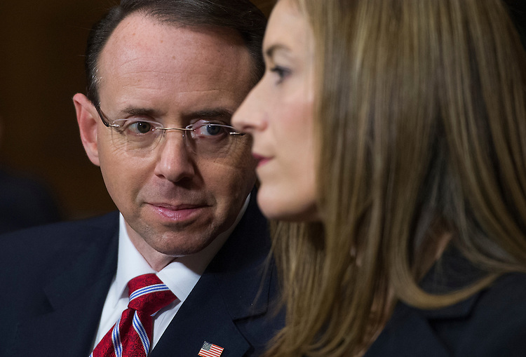 UNITED STATES - MARCH 7: Rod Rosenstein, nominee for deputy attorney general, and Rachel Brand, nominee for associate attorney general, talk during their Senate Judiciary Committee confirmation hearing in Dirksen Building, March 7, 2017. (Photo By Tom Williams/CQ Roll Call)