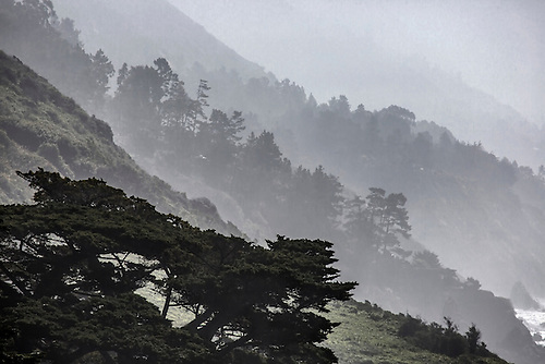 Fog rolls into the highlands along California's Pacific Ocean Coast at Big Sur.