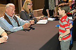"""Astronaut BUZZ ALDRIN get plaster replica of space shutter from KEATON COOKE, 6, of North Merrick, at the book signing for Aldrin's new books 'Mission to Mars"""" and the illustrated history of space exploration """"Look to the Stars."""" The NASA astronaut engineer of Apollo 11 in 1969, was the second person to walk on the Moon."""
