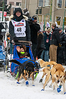 Riley Dyche and team leave the ceremonial start line with an Iditarider and handler at 4th Avenue and D street in downtown Anchorage, Alaska on Saturday March 7th during the 2020 Iditarod race. Photo copyright by Cathy Hart Photography.com