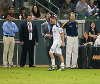 CARSON, CA – August 20, 2011: LA Galaxy head coach Bruce Arena and forward Robbie Keane (14) during the match between LA Galaxy and San Jose Earthquakes at the Home Depot Center in Carson, California. Final score LA Galaxy 2, San Jose Earthquakes 0.