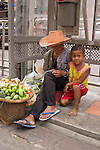 Woman and child selling fruit. Thailand