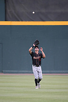 Jack Larsen (13) of the Modesto Nuts waits under a fly ball during a game against the the Visalia Rawhide at Recreation Ballpark on June 10, 2019 in Visalia, California. (Larry Goren/Four Seam Images)