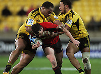 Neemia Tialataand Alapati Leiua tackle Tom Marshall. Super 15 rugby match - Crusaders v Hurricanes at Westpac Stadium, Wellington, New Zealand on Saturday, 18 June 2011. Photo: Dave Lintott / lintottphoto.co.nz