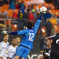 LA Keeper Brian Rowe punches the ball out of danger. DC United defeated the LA Galaxy 1-0 with a stoppage time goal from Chris Pontius at RFK Stadium in Washington DC.