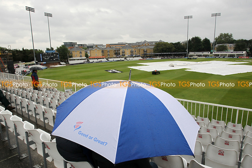 The covers are on and umbrellas are raised as rain prevents play starting on time - Essex Eagles vs Middlesex Panthers - Clydesdale Bank CB40 cricket at the Ford County Ground, Chelmsford, Essex - 18/07/12 - MANDATORY CREDIT: Gavin Ellis/TGSPHOTO - Self billing applies where appropriate - 0845 094 6026 - contact@tgsphoto.co.uk - NO UNPAID USE.