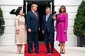 US President Donald J. Trump (C-L) and First Lady Melania Trump (R) welcome Korean President Moon Jae-in (C-R) and Mrs. Kim Jung-sook (L) to the South Portico of the White House in Washington, DC, USA, 11 April 2019. President Moon is expected to ask President Trump to reduce sanctions on North Korea in an attempt to jump start nuclear negotiations between North Korea and the US.<br /> Credit: Jim LoScalzo / Pool via CNP