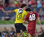 Football: Test Match, Liverpool FC - Borussia Dortmund. Borussia Dortmund midfielder Axel Witsel (28, left) and Liverpool midfielder Curtis Jones (48) vie for a header in their exhibition match on July 19, 2019 at Notre Dame Stadium. <br /> Tim Vizer/DPA