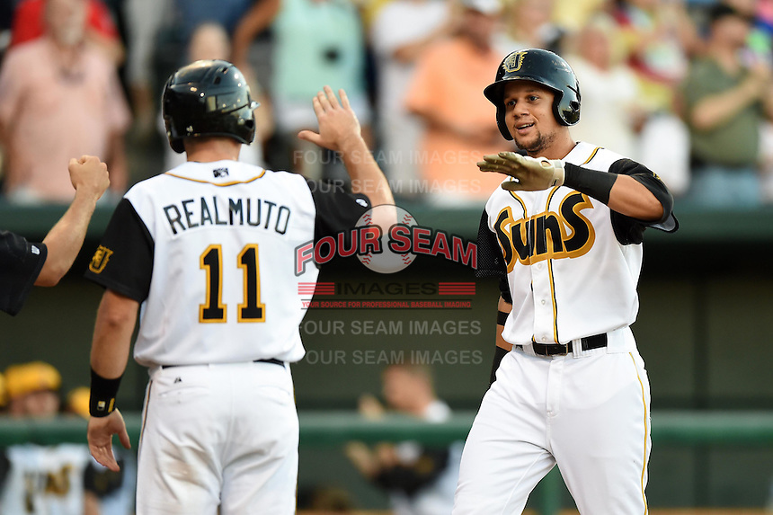 Jacksonville Suns first baseman Viosergy Rosa (44) high fives catcher J.T. Realmuto (11) after hitting a three run home run in the bottom of the first inning during game three of the Southern League Championship Series against the Chattanooga Lookouts on September 12, 2014 at Bragan Field in Jacksonville, Florida.  Rosa was named the series Most Valuable Player as Jacksonville defeated Chattanooga 6-1 to sweep three games to none.  (Mike Janes/Four Seam Images)