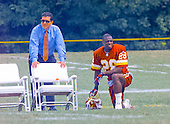 Washington Redskins owner Dan Snyder, left, and cornerback Darrell Green (28), right, watch the the team work out on the final day of the 2000 Washington Redskins training camp at Redskins Park in Ashburn, Virginia on August 17, 2000.<br /> Credit: Arnie Sachs / CNP
