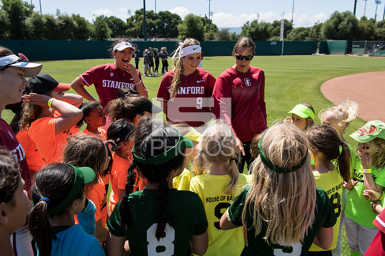 STANFORD, CA -- April 15, 2018. <br /> Kristina Inouye, Nikki Bauer, Tori Nyberg at softball clinic after the Stanford Cardinal women's softball team loss to the Oregon State Beavers at the Smith Family Stadium 12-1.