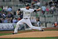 Starting pitcher P.J. Conlon (33) of the Columbia Fireflies delivers a pitch in the home opener against the Greenville Drive on Thursday, April 14, 2016, the team's first day at the new Spirit Communications Park in Columbia, South Carolina. The Mets affiliate moved to Columbia this year from Savannah. Columbia won, 4-1. (Tom Priddy/Four Seam Images)