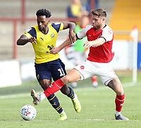 Oxford United's Tariqe Fosu is tackled by Fleetwood Town's Wes Burns<br /> <br /> Photographer Rich Linley/CameraSport<br /> <br /> The EFL Sky Bet League One - Fleetwood Town v Oxford United - Saturday 7th September 2019 - Highbury Stadium - Fleetwood<br /> <br /> World Copyright © 2019 CameraSport. All rights reserved. 43 Linden Ave. Countesthorpe. Leicester. England. LE8 5PG - Tel: +44 (0) 116 277 4147 - admin@camerasport.com - www.camerasport.com