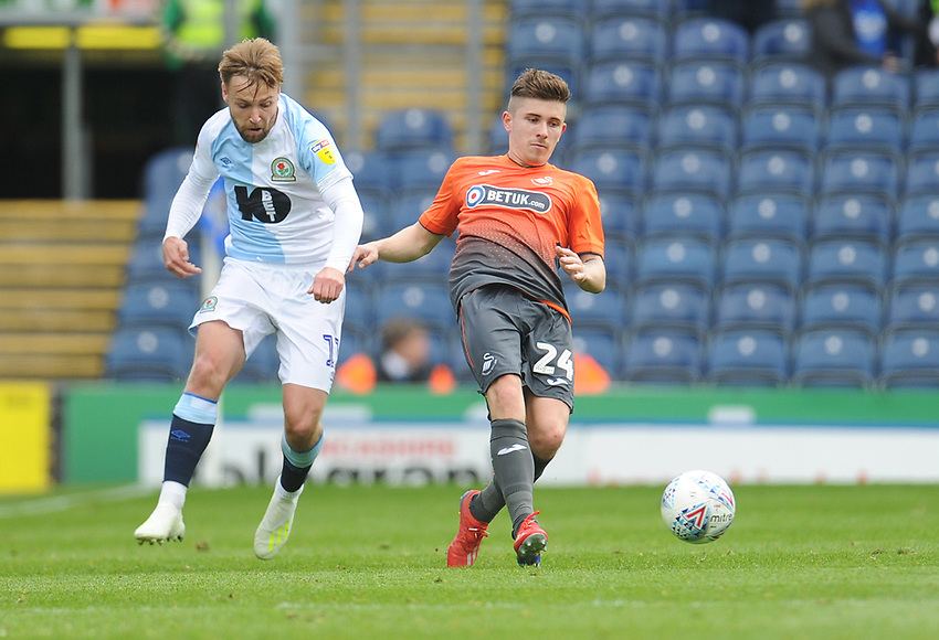 Swansea City's Declan John under pressure from Blackburn Rovers' Harry Chapman<br /> <br /> Photographer Kevin Barnes/CameraSport<br /> <br /> The EFL Sky Bet Championship - Blackburn Rovers v Swansea City - Sunday 5th May 2019 - Ewood Park - Blackburn<br /> <br /> World Copyright © 2019 CameraSport. All rights reserved. 43 Linden Ave. Countesthorpe. Leicester. England. LE8 5PG - Tel: +44 (0) 116 277 4147 - admin@camerasport.com - www.camerasport.com