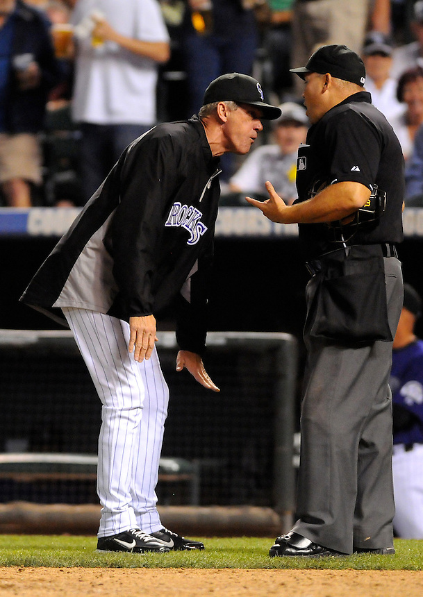 09 SEPTEMBER 2011:   Colorado Rockies manager Jim Tracy (4) argues with Umpire Mark Carlson, who ejected both Tracy and Carlos Gonzalez during a regular season game between the Cincinnati Reds and and the Colorado Rockies at Coors Field in Denver, Colorado.  The Reds beat the Rockies 4-1.  *****For Editorial Use Only*****