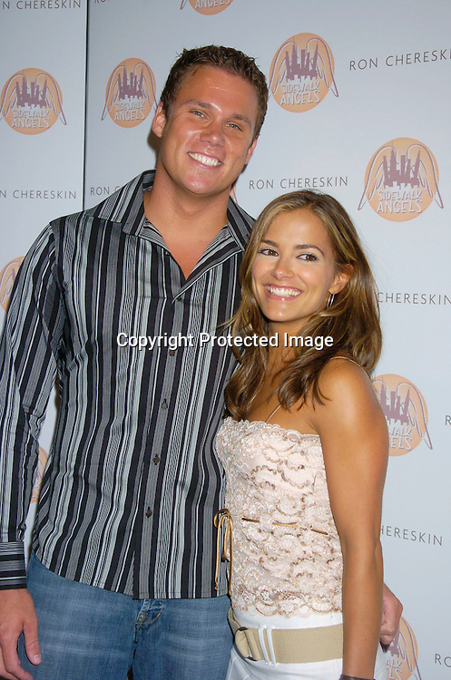Rebecca Budig and husband Bob Guiney..at the benefit for Sidewalk Angels Foundation on August 3, 2004 at The China Club. ..Photo by Robin Platzer, Twin Images..