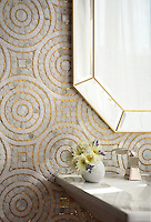 Orson, a hand-cut mosaic, shown in Shell, honed Thassos, polished Gold Glass, and polished Calacatta Gold.