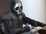 Person dressed in Cosplay outfit as grim reaperwith gun