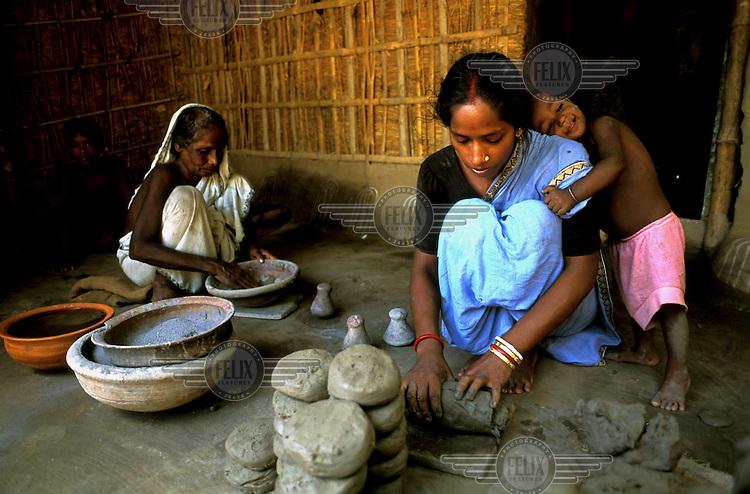 Women making clay pots in Sirajgonj.