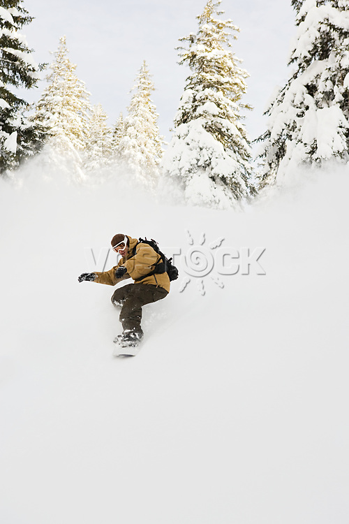 A man snowboarding<br />