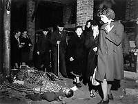 Citizens of Ludwigslust, Germany, inspect a nearby concentration camp under orders of the 82nd Airborne Division.  Bodies of victims of Nazi torture were found dumped in pits in yard, one pit containing 300 bodies.  May 6, 1945.  T4c. Jack Clemmer.  (Army)<br /> NARA FILE #:  111-SC-207193<br /> WAR & CONFLICT BOOK #:  1123