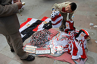 A boy sells revolution souvenirs in Tahrir square, after the revolution that saw president Hosni Mubarak ousted from office. Some protesters still occupied the Tahrir Square while life in other parts of the city returned to normal.