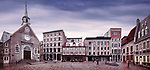 Panoramic view of Place Royale, the Royal Square with its famous Church of Notre-Dame-des-Victoires, statue of Louis XIV, shops and cafeterias on a rainy day at dusk. Old Quebec City. Quebec, Canada. Église Notre-Dame-des-Victoires, Ville de Québec.