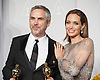 Alfonso Cuar&oacute;n poses with his Oscar and Angelina Jolie<br /> 86TH OSCARS<br /> The Annual Academy Awards at the Dolby Theatre, Hollywood, Los Angeles<br /> Mandatory Photo Credit: &copy;Dias/Newspix International<br /> <br /> **ALL FEES PAYABLE TO: &quot;NEWSPIX INTERNATIONAL&quot;**<br /> <br /> PHOTO CREDIT MANDATORY!!: NEWSPIX INTERNATIONAL(Failure to credit will incur a surcharge of 100% of reproduction fees)<br /> <br /> IMMEDIATE CONFIRMATION OF USAGE REQUIRED:<br /> Newspix International, 31 Chinnery Hill, Bishop's Stortford, ENGLAND CM23 3PS<br /> Tel:+441279 324672  ; Fax: +441279656877<br /> Mobile:  0777568 1153<br /> e-mail: info@newspixinternational.co.uk