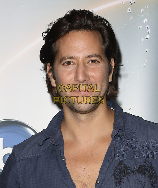 HENRY IAN CUSICK.Disney/ABC Television Group Press Junket held At The ABC Television Network Building, Burbank, California, USA..May 15th, 2010.headshot portrait blue.CAP/ADM/KB.©Kevan Brooks/AdMedia/Capital Pictures.