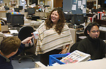 Teresa Vargas and Eli Reyes in cityroom of Newsday Melville office on Saturday March 26, 2005. (Photo Jim Peppler 2005).