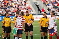 Referee Margaret Domika meets with Christie Rampone (3) of the United States (USA) and Zhou Gaoping (3) of China PR (CHN) prior to the start of the match. The United States (USA) women defeated China PR (CHN) 4-1 during an international friendly at PPL Park in Chester, PA, on May 27, 2012.