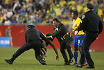 06 June 2008: Robinho (BRA) (11) watches as a fan, who ran onto the field and hugged him, is tackled. The Venezuela Men's National Team defeated the Brazil Men's National Team 2-0 at Gillette Stadium in Foxboro, Massachusetts in an international friendly soccer match.