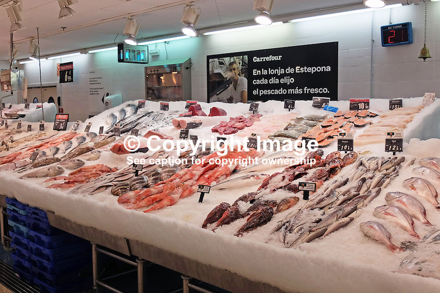 Fish counter, Carrefour, supermarket, Estepona, Costa del Sol, Spain, 201503160647<br />
