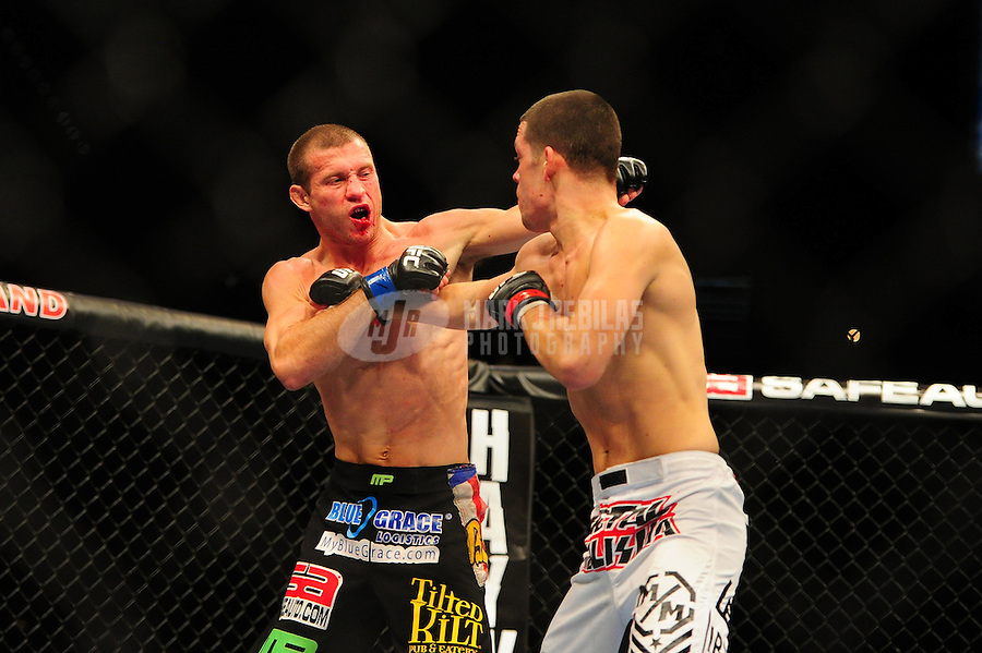 Dec 30, 2011; Las Vegas, NV, USA; UFC fighter Donald Cerrone (left) against Nate Diaz during a lightweight bout at UFC 141 at the MGM Grand Garden event center. Mandatory Credit: Mark J. Rebilas-
