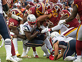 From left to right: Washington Redskins strong safety Landon Collins (20), strong safety Montae Nicholson (35), linebacker Montez Sweat (90), and linebacker Shaun Dion Hamilton (51) gang tackle New England Patriots running back Sony Michel (26) in fourth quarter action at FedEx Field in Landover, Maryland on Sunday, October 6, 2019.  The Patriots won the game 33 - 7.<br /> Credit: Ron Sachs / CNP