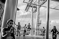 RIO DE JANEIRO, BRAZIL - FEBRUARY 17, 2014: Children hang out in between nearby kickboxing classes on the landing of an abandoned cable car station, built on the same spot as their old play ground, in the Providência favela on February 17, 2014 in Rio De Janeiro, Brazil. The mayor rode in the 75 million real (US$ 32 million) cable car in an event in 2012 but hasn't functioned since, as no business has been selected to manage the system. <br /> <br /> Daniel Berehulak for The New York Times