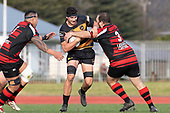 Cole Watson takes on Federick Cain and Nigel Beaver. Counties Manukau Premier Club Rugby game between Papakura and Bombay, played at Massey Park Papakura on Saturday June 16th 2018. Bombay won the game 36 - 17 after leading 17 - 7 at halftime.<br /> Papakura Ray White 17 - Kris Smithson 2, Taafaga Tagaloa tries, Monty Punatai conversion.<br /> Bombay 36 - Jordan Goldsmith, Haamiora Clarke 2, Patrick Masoe, Mitchell Thackham, Chay Mackwood tries, Jordan Goldsmith 2, Ki<br /> Anufe conversions.<br /> Photo by Richard Spranger.