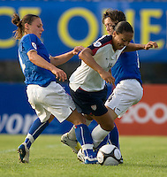 USWNT midfielder (16) Angela Hucles is fouled as she moves between Italy's (11) Silvia Fuselli and (4) Alessia Tuttino during the last group stage game at the Peace Queen Cup.  The USWNT defeated Italy, 2-0, at the Suwon Sports Center in Suwon, South Korea.