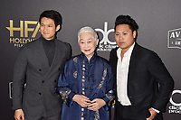 BEVERLY HILLS, CA - NOVEMBER 04: (L-R) Harry Shum Jr., Lisa Lu and Jon M. Chu arrive at the 22nd Annual Hollywood Film Awards at the Beverly Hilton Hotel on November 4, 2018 in Beverly Hills, California.<br /> CAP/ROT/TM<br /> &copy;TM/ROT/Capital Pictures