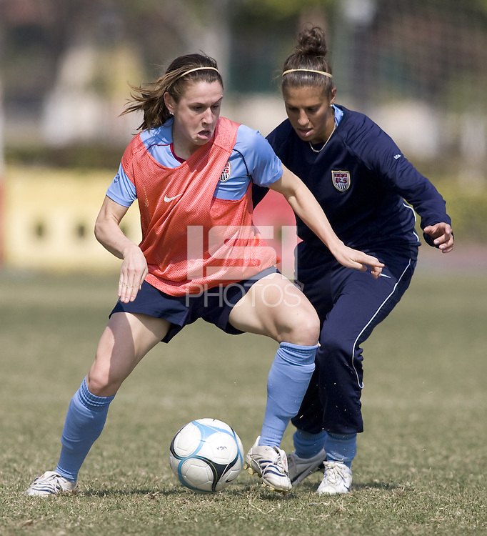 USA's Heather O'Reilly and Carli Lloyd during practice in preparation for the Four Nations Tournament in Guangzhou, China on January 15, 2008