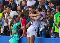 PARIS,  - JUNE 16: Alyssa Naeher #1 and Jess McDonald #22 hug people in the stands during a game between Chile and USWNT at Parc des Princes on June 16, 2019 in Paris, France.