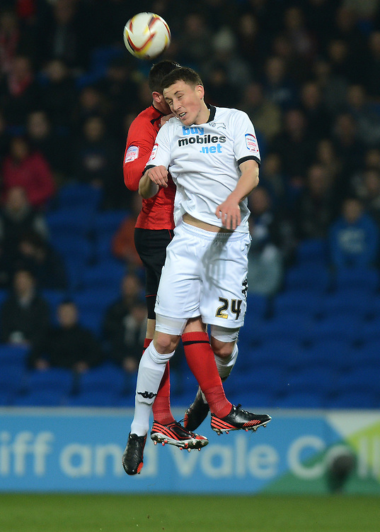 Derby County's Dean Forsyth beats Cardiff City's Andrew Taylor to the header..Football - npower Football League Championship - Cardiff City v Derby County - Tuesday 05th March 2013 - Cardiff City Stadium - Cardiff..© CameraSport - 43 Linden Ave. Countesthorpe. Leicester. England. LE8 5PG - Tel: +44 (0) 116 277 4147 - admin@camerasport.com - www.camerasport.com